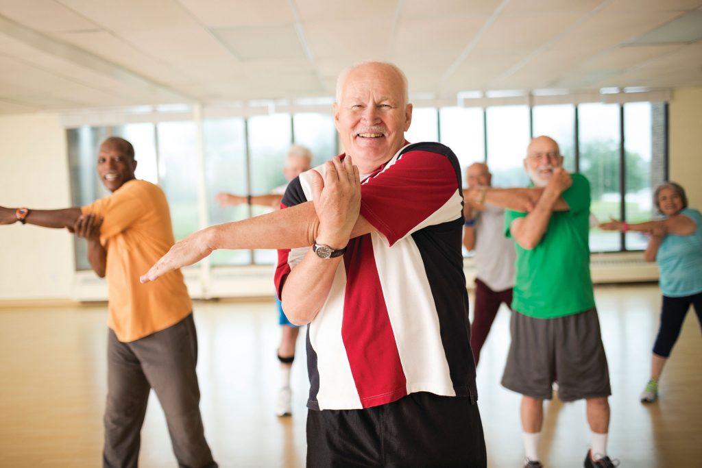Male seniors enjoying an exercise class