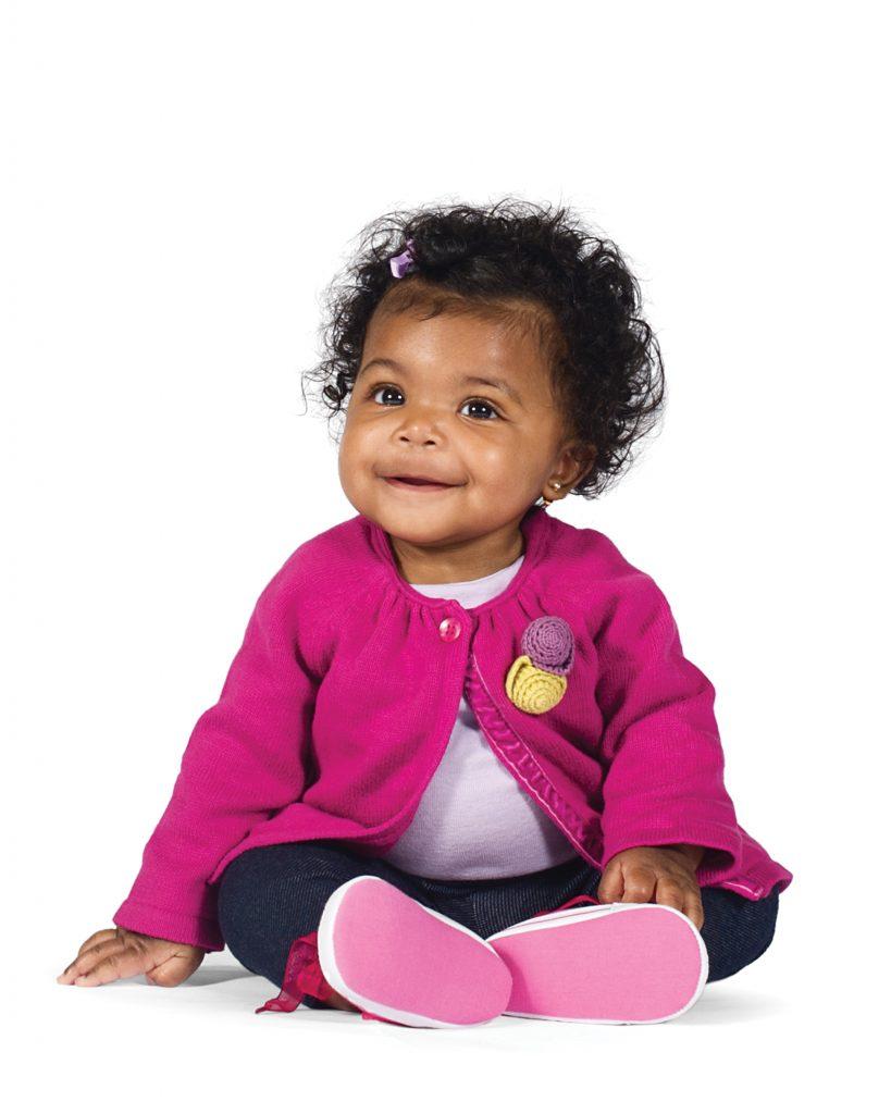 Sweet little girl in a pink sweater