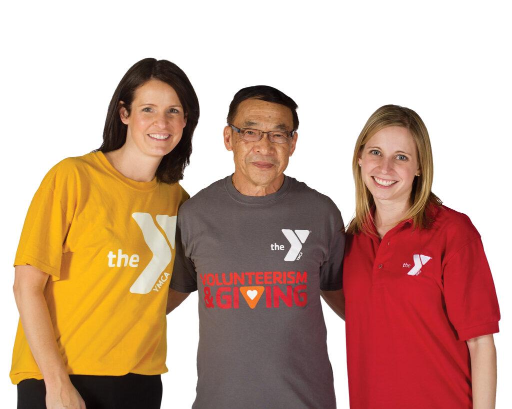 2 female staff members standing with an elderly male Y member
