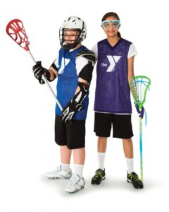 A girl & boy geared up and ready to play lacrosse